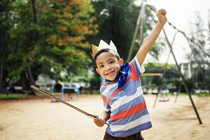 Young boy playing in garden