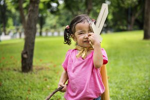 Little girl with paper sword