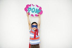 Superhero boy holding sigh board