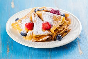 Crepes with berries, blueberry and strawberry