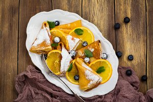 Crepes with orange slices and blueberry