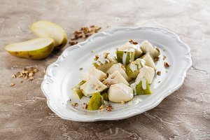 Pear with blue cheese sauce and nuts
