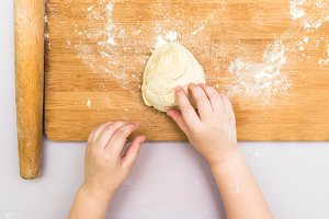 Children's hands make a dough