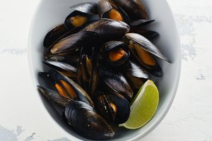 Mussels in white bowl