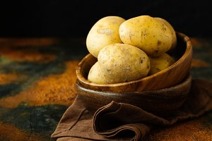 Raw potato food in wooden bowls