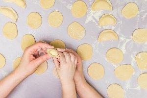Mother and child hand's make ravioli