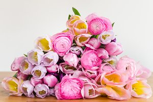 Bunch of Colorful Tulips and Pink Ranunculus Buttercup Flowers