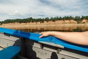 Boat moving at high speed on a beautiful Northern Dvina river in taiga forest, Russia, Arkhangesk region. Shot from inside the boat