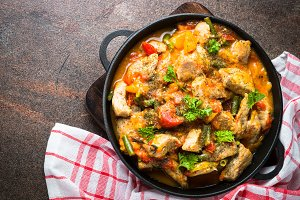 Stewed pork with vegetables in tomato sauce.