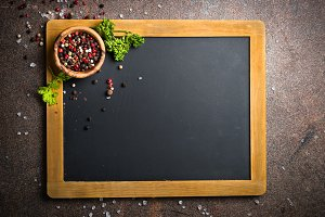 Food background with chalkboard and spices.