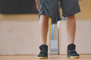 Man sportsman in sneakers - in the gym