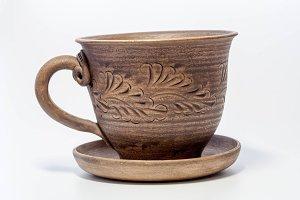 Clay mug with saucer