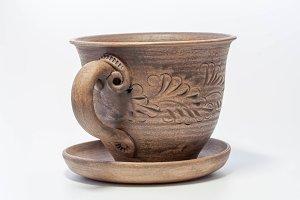 Clay mug with saucer, unfolded