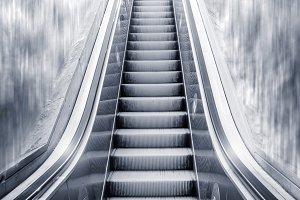 Futuristic escalator with man on top