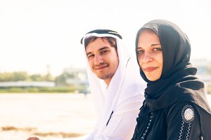 Arabian Couple Sitting On The Beach