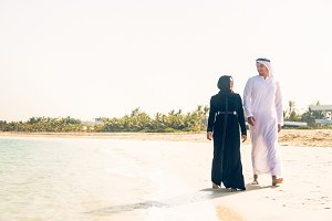 Arabian Couple Walking On The Beach