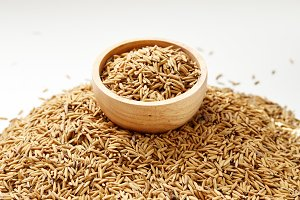 Paddy seeds in wooden Bowl