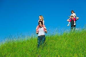Family Desceding A Hill