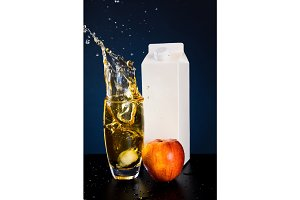 Glass Of Juice With Carton And Apple