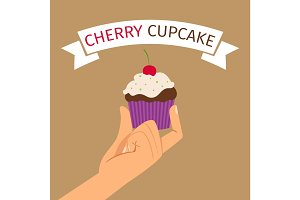 Hand holding cupcake with cherry