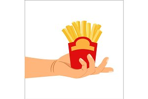 Hand holding french fries