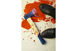 Man's Feet And Axe In Puddle Of Blood