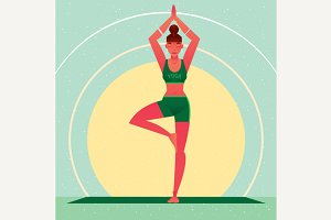 Girl standing in Yoga Tree Pose or Vrikshasana