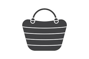 Beach bag glyph icon