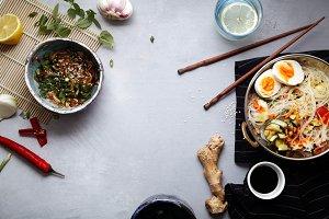 Spicy veggie wok on gray background