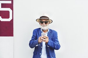 Elderly man is using mobile phone