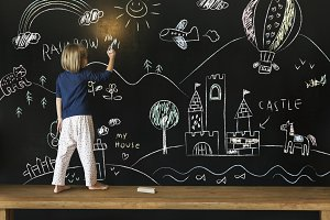 Girl drawing on a blackboard