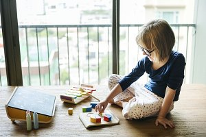 Girl playing with wooden toys