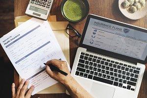 Senior couple computing expenses
