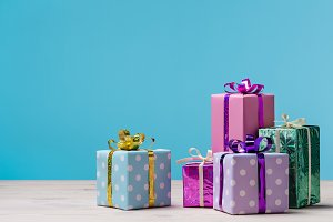 Many gift boxes on  blue background.