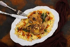Christmas roast duck legs and couscous