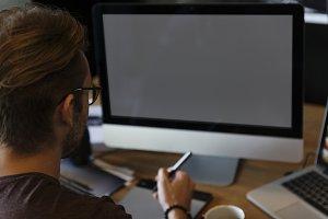Photographer using computer