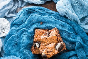 Cream cheese brownies with cookies on blue