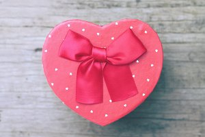 Heart shape gift box on wooden table
