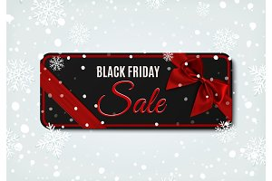 Black Friday sale banner with red ribbon and bow.