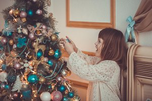 Girl kid near Christmas tree