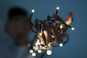 hand with the christmas lights