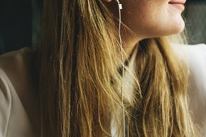 Woman is listening to music