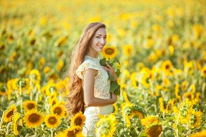 Smiling woman in sunflowers.