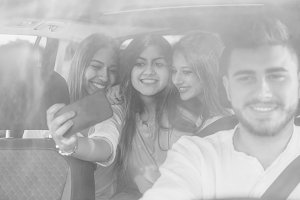 Selfie with a phone in a car