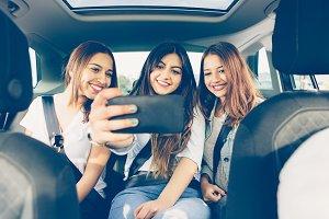 Friends making selfie in a car