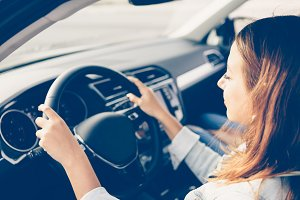 Close up of a girl driving a car
