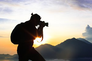 Photographer takes pictures on the mountain