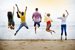 Friends jumping with joy