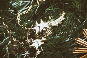 Christmas decoration with golden stars on Christmas tree.