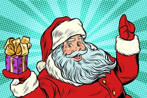 Santa Claus with gift. New year and Christmas
